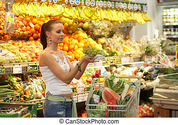 fruitshop - brunette beauty while shopping
