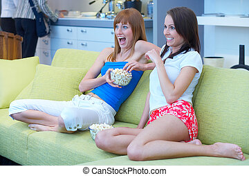 thriller - two girls sitting on the couch watching tv