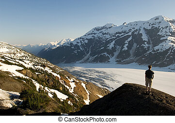 Salmon Glacier, Alas - Hiker looking at infinite alaskan...