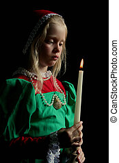 Ancient girl - Little girl with candle. Black background....