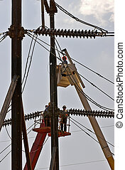 Linemen repairing high power electric lines