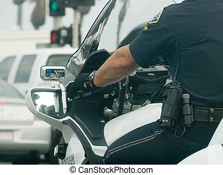 Motorcycle cop showing communication tools on belt