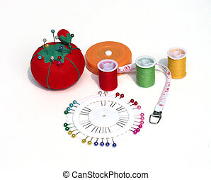 sewing supplies - variety of sewing supplies over white