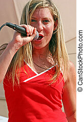 Singer - Young blond singer perform at a concert