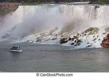 American Falls, Niagara Falls - Maid of the Mist floating by...