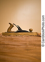 Wood Plane Profile - An old wood plane hand tool on a wooden...
