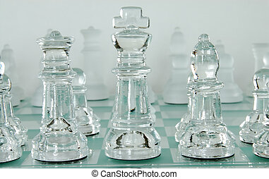Chess Pieces - Chess game with glass playing pieces.
