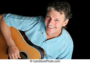 Grinning Guitarist - A handsome guitarist grinning up from a...