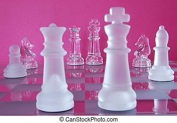 Chess King Queen Battle - Chess game in glass. The Queen and...