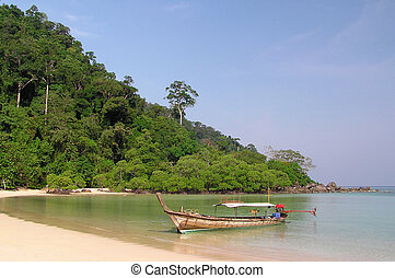 Exotic sea view - A longtail boat and a fantastic...
