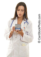 Medical Practitioner using a portable device with medical...