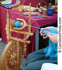 Spinning wool 2 - A woman spinning colourful wool on a...
