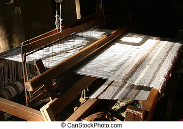 Loom - A loom of a weaver in hard lighting.