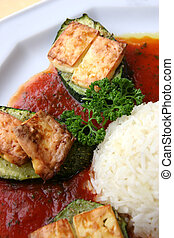 Vegetarian food - A plate of baked zucchini and rice with...