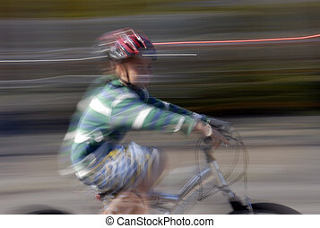 Boy on Bike - Young boy riding a bicycle