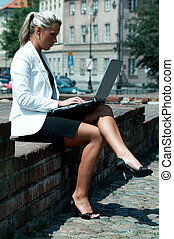 Business outdoor - Business women working with laptop...