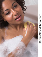 Cleaning lady - Beautiful black woman taking a relaxing...