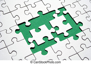Jigsaw conceptual - Two white jigsaws pieces on a jigsaw...