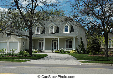 Luxury House - Pretty luxury stucco house with white trim...