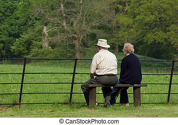 Peaceful Retirement - Elderly couple sitting together on a...
