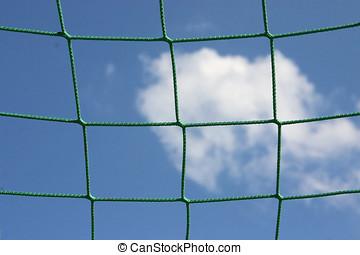 Goal netting - Net of gate against the sky on the football...