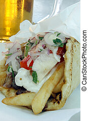 greek gyro - tasty greek gyro tzatziki and a draft beer