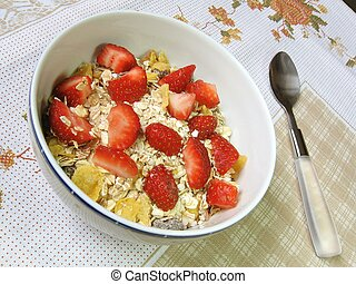 Breakfast cereals - A bowl of granola and strawberries on a...