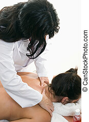 Bodywork - Therapist giving a back and shoulder massage -...