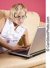 Working home - Woman with notebook on the sofa