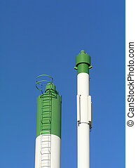 smokestack - Green and white smokestack against clear blue...