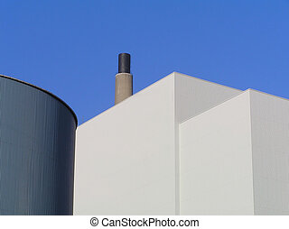 smokestack - Factory buildings with smokestack against clear...