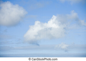 Stock Photo of Three Clouds in a Blue Sky - Photo of three...