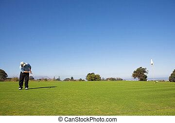 Golfer #50 - A golfer playing golf on a green