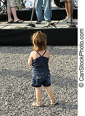 Live Music - Small child watching live outdoor concert.