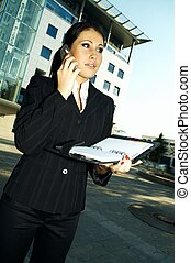 Business Outdoors - Business woman using a mobile phone