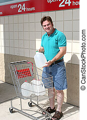 Hurricane Water Jugs - A man with a shopping cart full of...