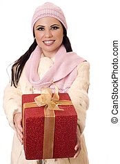 Female holding wrapped present. - Smiling female holding a...