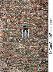 Brick wall with small window