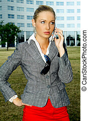 Business Outdoors 2 - Business woman using a mobile phone
