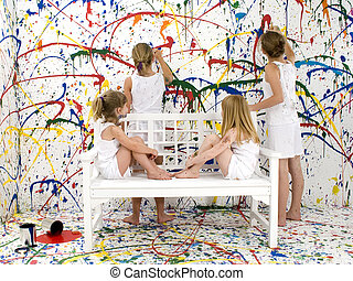 Paint Girls - Four young girls painting room in bright...