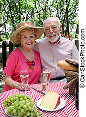 Seniors on Picnic - An attractive senior couple enjoying a...