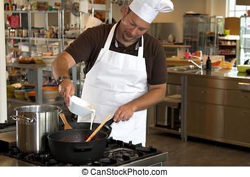 Adding some cream - Italian chef adding some cream into the...