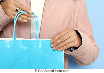 Shopping - A woman carrying a shopping bag
