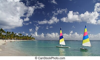 Beautiful caribbean lagoon with two colorful jolly boats