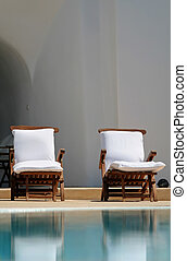 Chairs at the swimming pool at Santorini Greece