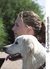 Woman and her dog en profile - Pretty blond woman and her...