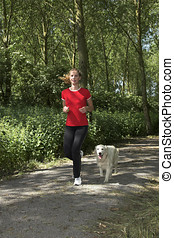 Woman out for a run with the dog - Pretty blond woman...