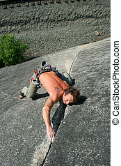 Hang on for your life. - A climber struggles up a...