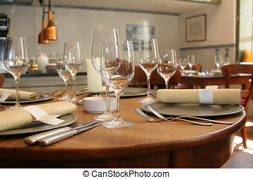 Table setting in a restaurant (shallow DOF, focus on the...