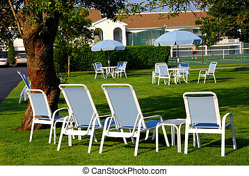 Lawn chairs hotel - Patio furniture on the lawn in front of...